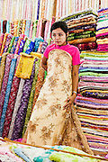 Showing off wedding dress fabric at Scott's Market, Yangon, Myanmar.
