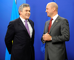 Gordon Brown, the U.K.'s prime minister, left, speaks with Fredrik Reinfeldt, Sweden's prime minister and standing president of the European Council, as he arrives for the European Summit at the EU headquarters in Brussels, Belgium, on Thursday, Sept. 17, 2009. European Union leaders may call for sanctions on banks that pay excessive bonuses, fearing that runaway executive pay could trigger another financial crisis, a draft text showed. (Photo © Jock Fistick) *** Local Caption *** Gordon Grown