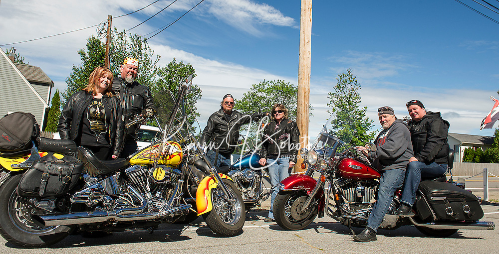 Cyndie Urquhart and Vance Nash, Dave and Lorraine Jeans both from Maine and Mike and Shannon Nash from Connecticut are ready to ride after breakfast at Nothin' Fancy on Route 3 Friday morning.  (Karen Bobotas/for the Laconia Daily Sun)