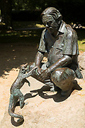 Bronze statue of Gerald Durrell, naturalist and author, with a coati at Jersey Zoo - Durrell Wildlife Conservation Trust, Channel Isles