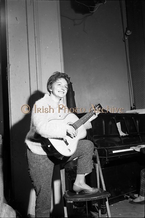 "26/05/1962<br /> 05/26/1962<br /> 26 May 1962<br /> Rehersal in Gael-Linn's Damer theatre in preparation for first ever review ""Damertásibh"", due to open on the 30th May. In a addition to ""Tontoletto"" a short play by Micheal Mac Liammóir, there were sketches by Niall Toibín;  Eoghan O Tuairisc; Sean O Riada and Tomas Mac Anna, dealing with subjects like the ""Playboy Movie"", Telefis Eireann, Lord Nelson and the Gael Linn Newsreel of 2062. Music was by Peadar O Briain and production was by Tomas Mac Anna. Picture shows Aine Ní Mhuirí who appeared in the review Ilshiamsa an Damer."