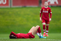 LIVERPOOL, ENGLAND - Monday, February 24, 2020: Liverpool's Neco Williams lies injured during the FA Premier League match between Liverpool FC and West Ham United FC at Anfield. (Pic by David Rawcliffe/Propaganda)