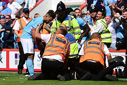 Sergio Aguero of Manchester City is held back by a steward after he checks to see if a fan is okay. - Mandatory by-line: Alex James/JMP - 26/08/2017 - FOOTBALL - Vitality Stadium - Bournemouth, England - Bournemouth v Manchester City - Premier League