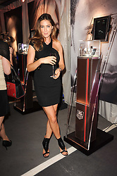 LISA SNOWDON at a party to celebrate 150 years of TAG Heuer held at the car park at Selfridge's, London on 15th September 2010.