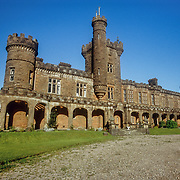 """I was now camping near Kinloch Castle built by Sir George Bullough in 1900. His father, John Bullough, was a millionaire from Lancashire, who like many entrepreneurs at the time, especially in the north of England, made his fortune from the Industrial Revolution; In his case as a manufacturer of cotton machinery. After buying the island in 1888 he continued to use it as a sporting estate until his death in 1891, but when his son took over the island he used the fortune he inherited from his father to take it to the next level of upper class extravagance. To build the castle he had to import all of the raw materials to the island. The sandstone used for its construction was quarried in Dumfries and Galloway. At the time there were about 100 people employed on the estate who were paid extra to wear kilts to work on the extensive grounds that included a nine-hole golf-course, tennis and squash courts, heated turtle and alligator ponds, and an aviary including birds of paradise and humming birds. Soil for the grounds was imported from Ayrshire, and figs, peaches, grapes and nectarines were grown in greenhouses. The interior boasted an amazing """"orchestrian"""" device that could simulate the sounds of brass, drum and woodwind, an air- conditioned billiards room, and also a Jacuzzi.<br /> I was fascinated by the place and took advantage of a guided tour. I also ate in the small café at the back of the castle as well as taking a shower in one of the original bathrooms fitted with an innovative plumbing system. Sir George Bullough also used his wealth to travel around the world, and throughout the castle there are interesting artefacts that he collected on his travels, including his large collection of photographs, as he was also a keen photographer. The ballroom, that had a concealed balcony for an orchestra, was particularly atmospheric, and I could visualise the lavish parties that were held there for all of his high society guests from the upper class elite of the UK."""
