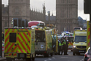 Scenes on Westminster Bridge after four people were killed (including the attacker) and 20 injured during a terrorist attack on Westminster Bridge and outside the Houses of Parliament, on 22nd March 2017, in central London, England. Parliament was in session and all MPs and staff and visitors were in lock-down while outside, the public and traffic were kept away from the area of Westminster Bridge and parliament Square, the scenes of the attack. It is believed a lone man crashed his car into pedestrians then, armed with a knife tried to enter Parliament, stabbing and killing a police officer at parliament's main gates.