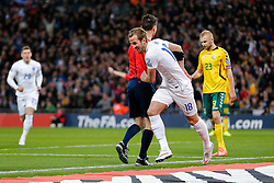 Harry Kane of England (Tottenham Hotspur) collides with the 5th official as he celebrates scoring a goal with a header to make it 4-0 - Photo mandatory by-line: Rogan Thomson/JMP - 07966 386802 - 27/03/2015 - SPORT - FOOTBALL - London, England - Wembley Stadium - England v Lithuania UEFA Euro 2016 Qualifier.