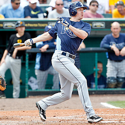 March 22, 2012; Bradenton, FL, USA; Tampa Bay Rays shortstop Elliot Johnson (9) lines out to right field during the top of the fourth inning of a spring training game against the Pittsburgh Pirates at McKechnie Field. Mandatory Credit: Derick E. Hingle-US PRESSWIRE