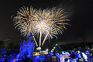 A crowd watches fireworks in celebration of Independence Day Sunday July 3, 2016 at Sesame Place in Langhorne, Pennsylvania. Photo by William Thomas Cain