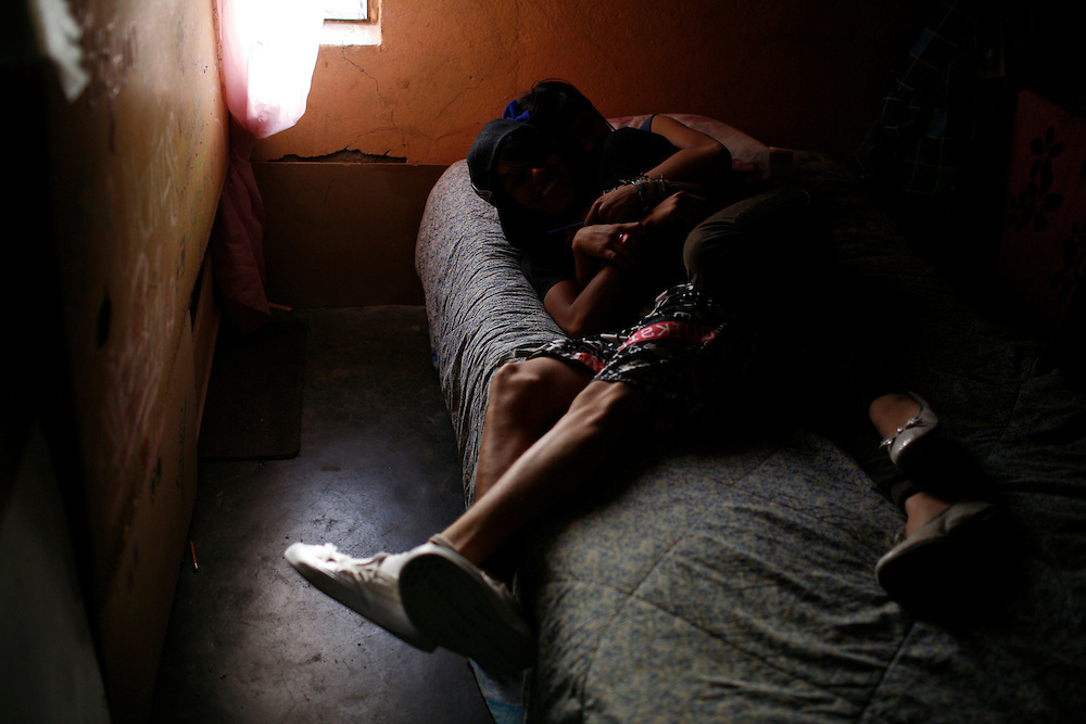 "From left, Jose ""Pollo"" Miguel, 16, and Denise Fuentes, 14, lay on a bed at her home in the Diaz Ordaz colonia in Ciudad Juarez, Chihuahua Mexico on April 28, 2010. ."