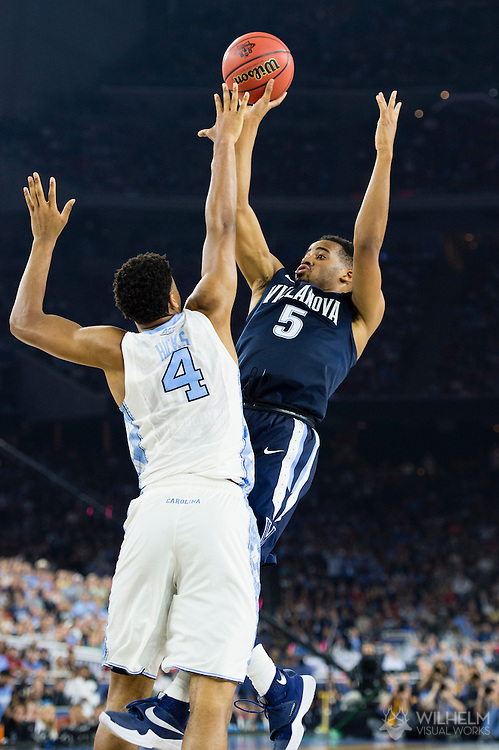 04 APR 2016: Guard Phil Booth (5) of Villanova University with the fadeaway jumper in front of Forward Isiah Hicks (4) of the University of North Carolina during the 2016 NCAA Men's Division I Basketball Final Four Championship game held at NRG Stadium in Houston, TX. Villanova defeated North Carolina 77-74 to win the national title. Brett Wilhelm/NCAA Photos