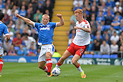 Portsmouth Forward, Curtis Main (14) and Crawley Town Defender, Josh Yorwerth (15) during the EFL Sky Bet League 2 match between Portsmouth and Crawley Town at Fratton Park, Portsmouth, England on 3 September 2016. Photo by Adam Rivers.