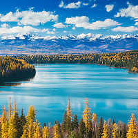 Scenic view of Holland lake, Swan valley, Swan mountain range and Mission mountains (aka the American Alps) from Holland Falls National Recreation Trail, northwest Montana.  Autumn colors of ponderous pine, red fir, and western larch frame the lake.  Published in Sunset western lifestyle magazine's Be Here Now travel feature, autumn 2014 issue, print and online editions. Finalist, Outdoor Photographer magazine's 2016 American Landscape competition. Featured in Outdoor Photographer print, digital and website advertisements for 2017 American Landscape competition. Willow Creek Press 2018 selection for Psalms calendar.