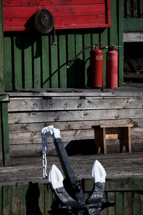 Fire extinguishers at the port sea office in Barentsburg, a Russian coal mining town in the Norwegian Archipelego of Svalbard. Once home to about 2000 miners and their families, less than 500 people now live here.