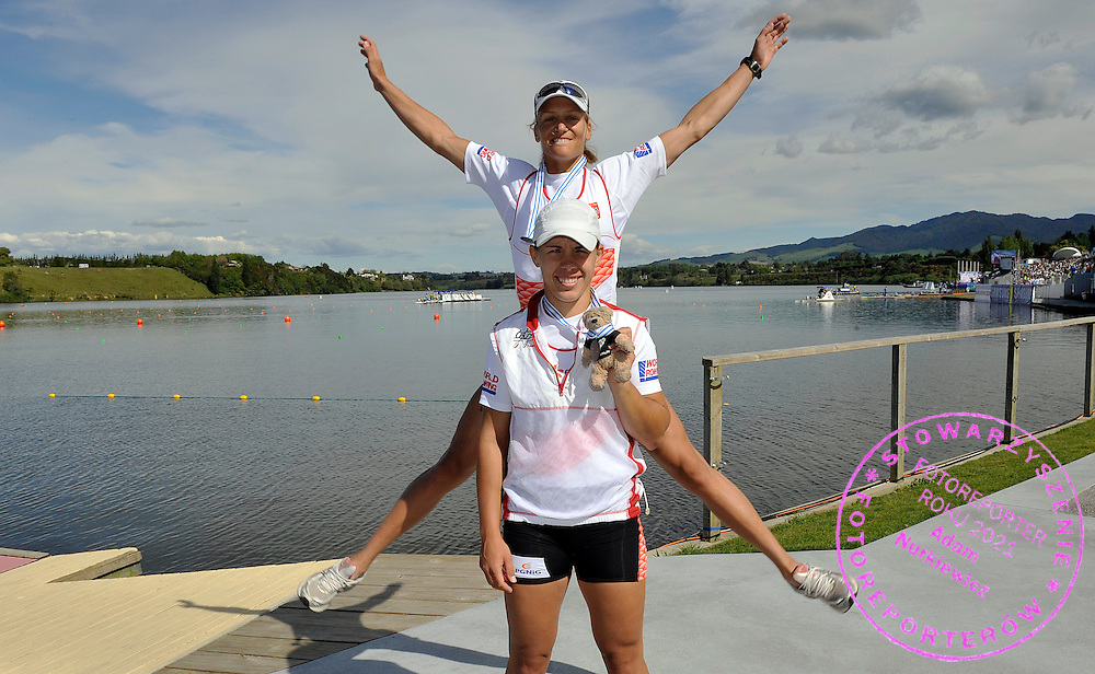 (L) JULIA MICHALSKA & (R) MAGDALENA FULARCZYK (BOTH POLAND) AND ZENEK BETWEEN THEM CELEBRATE THEIR BRONZE MEDALS AFTER WOMEN'S DOUBLE SCULLS FINAL A DURING REGATTA WORLD ROWING CHAMPIONSHIPS ON KARAPIRO LAKE IN NEW ZEALAND...NEW ZEALAND , KARAPIRO , NOVEMBER 07, 2010..( PHOTO BY ADAM NURKIEWICZ / MEDIASPORT )..PICTURE ALSO AVAIBLE IN RAW OR TIFF FORMAT ON SPECIAL REQUEST.