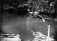 1..Tagbanua boatman dives into hidden lagoon, Coron Island, Philippines.