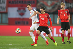 March 21, 2019 - Vienna, Austria - Arkadiusz Milik of Poland, Florian Grillitsch of Austra during the UEFA European Qualifiers 2020 match between Austria and Poland at Ernst Happel Stadium in Vienna, Austria on March 21, 2019. (Credit Image: © Foto Olimpik/NurPhoto via ZUMA Press)