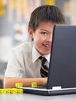 School Boy Using a Laptop