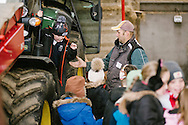 Adam Henson talks to kids from Inverurie Market Place School during RNCI visit to Colyhill Farm, Inverurie, Scotland.