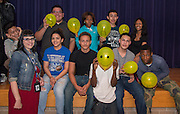 Chavez High School instructor April Feranda, left, poses with members of her freshmen freshman after they participated in a STAAR relay contest during a rally, March 27, 2014.