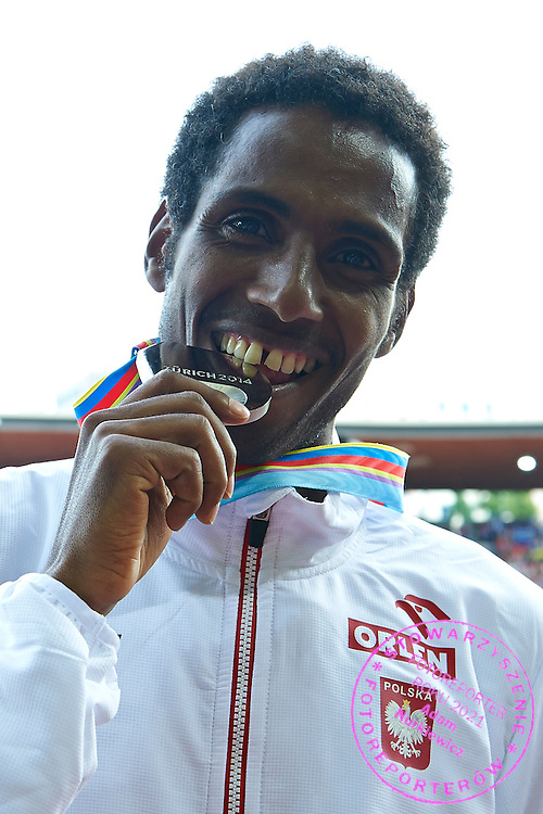 Yared Shegumo from Poland poses with his silver medal in men's marathon while medal ceremony during the Sixth Day of the European Athletics Championships Zurich 2014 at Letzigrund Stadium in Zurich, Switzerland.<br /> <br /> Switzerland, Zurich, August 17, 2014<br /> <br /> Picture also available in RAW (NEF) or TIFF format on special request.<br /> <br /> For editorial use only. Any commercial or promotional use requires permission.<br /> <br /> Photo by &copy; Adam Nurkiewicz / Mediasport