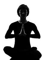 woman sukhasana pose meditation yoga posture position in silouhette on studio white background
