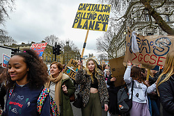 © Licensed to London News Pictures. 15/03/2019. LONDON, UK. Students march down Whitehall. Thousands of students take part in a Climate Change strike in Parliament Square, marching down Whitehall to Buckingham Palace.  Similar strikes by students are taking part around the world demanding that governments take action against the effects of climate change.  Photo credit: Stephen Chung/LNP