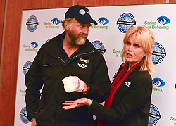"© Licensed to London News Pictures. 04/03/2013. Heathrow, UK Sir Ranulph Fiennes, with his left hand bandaged, talks with Joanna Lumley - Expedition Trustee. Explorer Sir Ranulph Fiennes returns to the UK after pulling out of ""The Coldest Journey"" Expedition to the Antarctic at winter due to frostbite. The Coldest Journey Press Conference today 4th March 2013 at Heathrow Airport. Photo credit : Stephen Simpson/LNP"