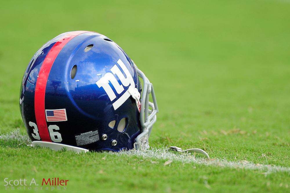 A New York Giants helmet sits on the field prior to the Giants NFL preseason game against the Jacksonville Jaguars at EverBank Field on August 10, 2012 in Jacksonville, Florida. ..©2012 Scott A. Miller..