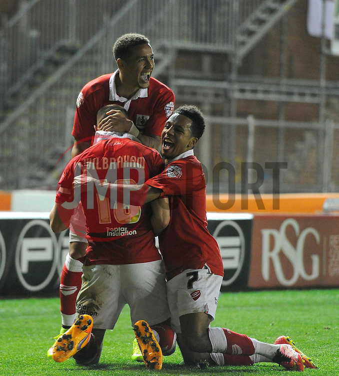 Bristol City's Aaron Wilbraham celebrates his goal with Bristol City's James Tavernier and Bristol City's Korey Smith  - Photo mandatory by-line: Joe Meredith/JMP - Mobile: 07966 386802 - 07/04/2015 - SPORT - Football - Bristol - Ashton Gate - Bristol City v Swindon Town - Sky Bet League One