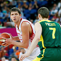 08 August 2012: Russia Victor Khryapa looks to pass the ball past Lithuania Martynas Pocius during 83-74 Team Russia victory over Team Lithuania, during the men's basketball quarter-finals, at the 02 Arena, in London, Great Britain.
