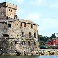 Castle on the Sea in Rapallo, Italy <br /> Since the first settlers arrived around the 8th century B.C., Rapallo, Italy has been plagued by battles with the Lombards, Aragonese, Ottomans, French and Germans.  The Castello sul Mare, which translates to Castle on the Sea, was built in the mid-16th century to defend against the Barbary pirates who looted the town and kidnapped young women.  Since then, it has been used by the Captaincy of Rapallo, a prison, the Palace of Justice and now a major art exhibition.  Attached to the castle is the St. Cajetan chapel which was built in 1688.