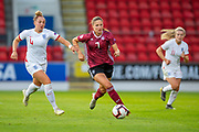 Melissa Kossler (#7) of Germany runs past Aimee Palmer (#4) of England during the UEFA Women's U19 Championship match between England Women and Germany at McDiarmid Stadium, Perth, Scotland on 16 July 2019.