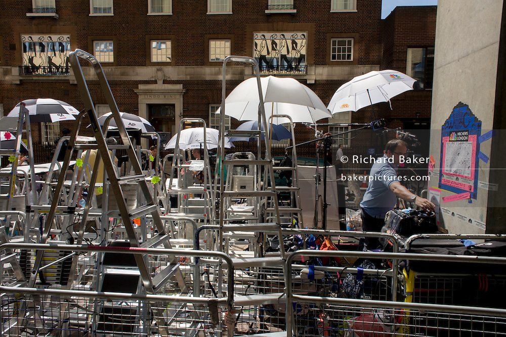 Media village behind railings as tension mounts outside St Mary's Hospital, Paddington London, where media and royalists await news of Kate, Duchess of Cambridge's impending labour and birth. Some have been camping out for up to two weeks during a UK heatwave, having bagged the best locations where an heir to the British throne will eventually be shown to the world.