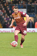 Bradford City Defender, Anthony McMahon on the ball making a pass through the middle during the The FA Cup third round match between Bury and Bradford City at Gigg Lane, Bury, England on 9 January 2016. Photo by Mark Pollitt.