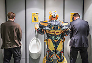 UNITED KINGDOM, London: 23 October 2015 A cosplay fan dressed as a Transformer needs a break in full costume at the 2015 MCM London Comic Con which is being held at London's ExCel Arena. The event will be host to more than 110,000 comic con fans and cosplay enthusiasts over the weekend. Rick Findler / Story Picture Agency