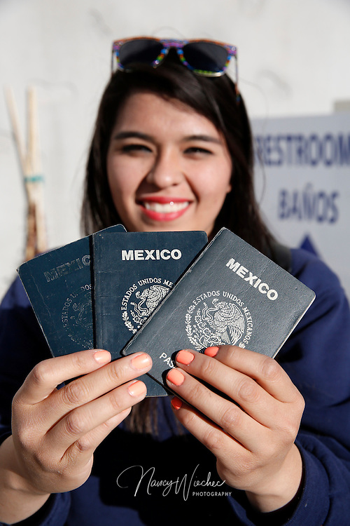 Marian Enriquez, 18, displays her various passports that allow her entry into the United States at the Mariposa border crossing in Nogales, Ariz. A student at Lourdes Catholic School and a member of Kino Teens, Marian is a Mexican citizen who crosses the border every weekday to attend school. She is holding her Mexican passport, a U.S. tourist visa and a U.S. student visa. She can be called on to present any one or all of the documents when entering the U.S. (Photo taken April 2, 2014) (Photo by Nancy Wiechec)