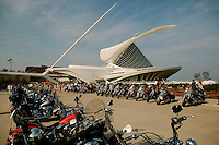 Harley Davidson bikes line up in large numbers infront of the Milwaukee Art Museum Friday Aug. 29, 2003 Milwaukee. Thousands of Harley Davidson bikers from all over the world came to Wisconsin to help celebrate Harley Davidson 100th anniversary.   photo by Darren Hauck