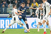 Luke Shaw is tackled by Juventus Midfielder Miralem Pjanic during the Champions League Group H match between Juventus FC and Manchester United at the Allianz Stadium, Turin, Italy on 7 November 2018.