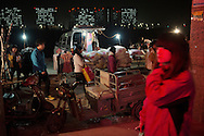 Zhengzhou November 21st 2012.Foxconn workers passing by makeshift stores close to their dorms. The sudden influx of young workers in what was a rural suburb of Zhengzhou has attracted many small businesses ran by locals and catering to the workers needs..Credit: Gilles Sabrie.Note: not shot on assignment!.