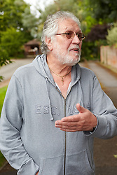 © Licensed to London News Pictures.  16/08/2013. MENTMORE, UK. Dave Lee Travis (pictured) talks to photographers outside his home in Mentmore. He was charged yesterday under his real name of David Patrick Griffin with 11 counts of indecent and one count of sexual assault. Photo credit: Cliff Hide/LNP