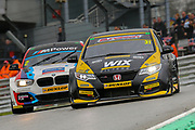Jack Goff holds off the challenging Colin Turkington during the Dunlop MSA British Touring Car Championship at Brands Hatch, Fawkham, United Kingdom on 8 April 2018. Picture by Aaron  Lupton.