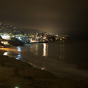 Nightfall at Laguna Beach - city lights along California 1 (PCH) and the natural soundtrack of the Pacific Ocean beating the shore.