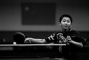 A boy smacks a ball as he plays table tennis in the Shichahai Sports School in Beijing.