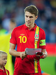 CARDIFF, WALES - Tuesday, September 10, 2013: Wales' captain Aaron Ramsey reads out a FIFA message before the 2014 FIFA World Cup Brazil Qualifying Group A match against Serbia at the Cardiff CIty Stadium. (Pic by David Rawcliffe/Propaganda)