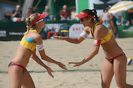 STARE JABLONKI POLAND - July 2: Romana Kayser /1/ and Muriel Graessli of Switzerland in action during Day 2 of the FIVB Beach Volleyball World Championships on July 2, 2013 in Stare Jablonki Poland.  (Photo by Piotr Hawalej)
