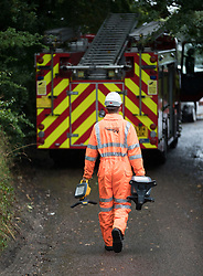 © Licensed to London News Pictures. 16/09/2016. Watford, UK. A network rail emergency worker is seen near the entrance to a tunnel where a train has derailed near Watford, following heavy rainfall over night. Photo credit: Peter Macdiarmid/LNP