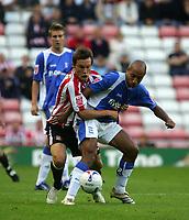 Photo: Andrew Unwin.<br /> Sunderland v Birmingham City. Coca Cola Championship. 09/08/2006.<br /> Sunderland's Dean Whitehead (L) battles with Birmingham's Medhi Natfti (R).