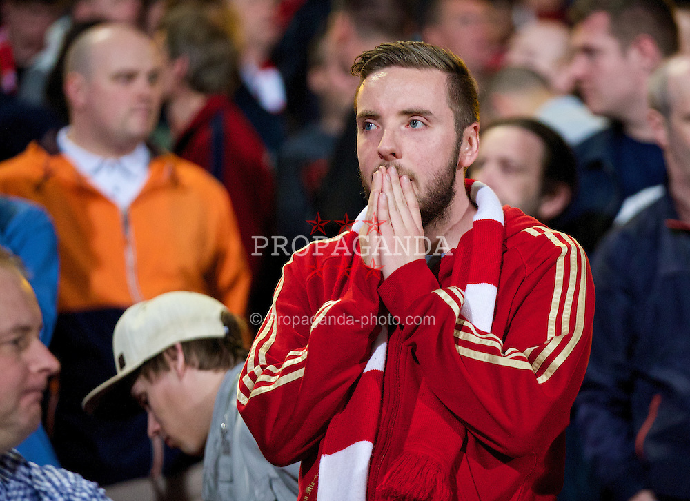 LONDON, ENGLAND - Monday, May 5, 2014: A Liverpool supporter looks dejected after the 3-3 draw against Crystal Palace during the Premiership match at Selhurst Park. (Pic by David Rawcliffe/Propaganda)