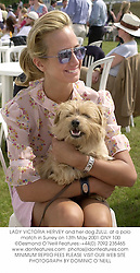 LADY VICTORIA HERVEY and her dog ZULU, at a polo match in Surrey on 13th May 2001.	ONY 100
